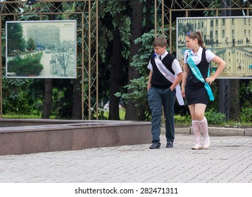 Makeevka, Ukraine - May 29, 2015: Graduates near the fountain. The first issue after the beginning of the military conflict in the territory controlled by the People's Republic of Donetsk.
