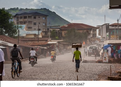 MAKENI, SIERRA LEONE - June 06, 2013: West Africa, group of unknown people along the Makeni highway, Sierra Leone