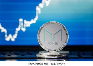 MAKER (MKR) cryptocurrency; silver maker coin on the background of the chart