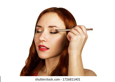 Makeup artist applies eye shadow. beauty woman face, painting cosmetics of young model girl . Make up in process, isolated.