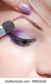 Makeup artist applying beautiful make up eyeshadow