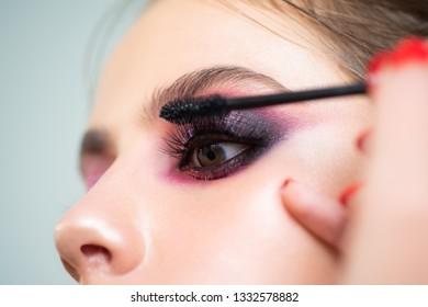 Make-up artist applying the mascara to model. Sexy Lady, Fashion, Beauty