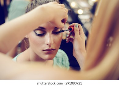 Make-up artist applying the mascara to model. Close up.  - Shutterstock ID 291080921