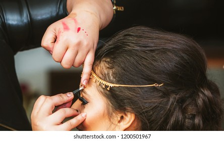 Makeup artist assisting the beautiful Indian Bridal Karachi, Pakistan, October 01, 2018