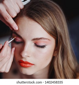 Makeup artist does makeup for the model