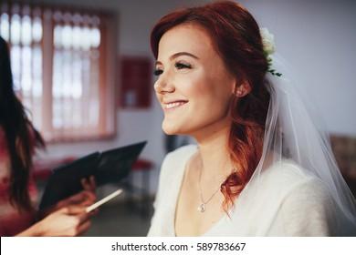 The makeup artist doing a makeup for bride