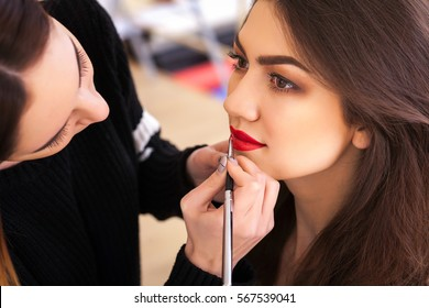 make-up artist doing make-up girl in the salon, beauty concept and self-care