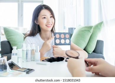 make-up artist girl shows the products of cosmetics, which was made makeup. the concept of beauty