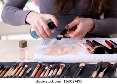 Make-up artist preparing brushes for work