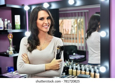 makeup artist woman stand in her salon