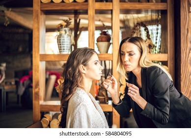 Make-up artist work on her friend.Real people.