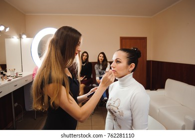 Make-up artist work on her friend. Real people.