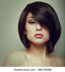 Makeup beautiful woman face with short hair style. Vintage portrait