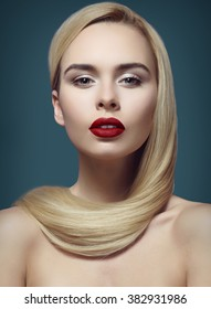 makeup, beautiful and young blonde with long groomed hair