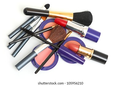 makeup brush and cosmetics isolated on a white background