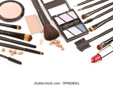 makeup brush and cosmetics isolated on a white background isolated with space for your text