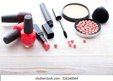 makeup brush and cosmetics make up artist objects: lipstick, eye shadows, eyeliner, concealer, nail polish, powder, tools for make-up