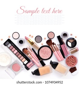 Makeup brush and decorative cosmetics on a white background with copy space. Top view