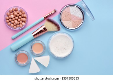 Makeup brush and decorative cosmetics on color background. Minimal style. Top view