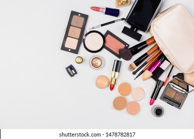 Makeup brush and decorative cosmetics on a white background. Top view