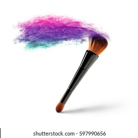 Makeup brush with multicolored powder splash on a white background.