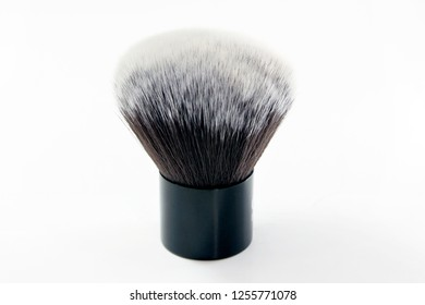 Makeup brush on white background. Kabuki brush for applying powder.