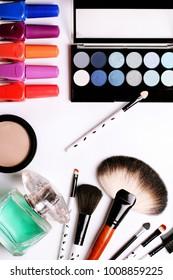 make-up brush, perfume, eye shadow, blush at the white background