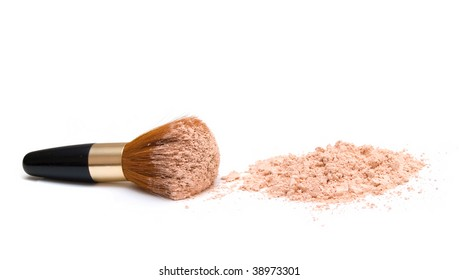make-up brush with powder on it and heap of powder