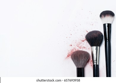Makeup brush with the remnants of the blush and powder