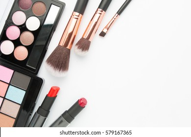 Makeup brush set with eye shadow palette on white  background