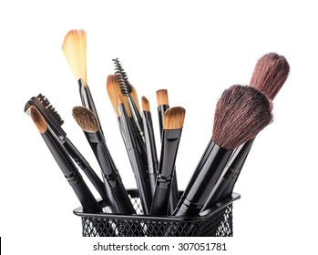 Makeup brush set in a glass isolated on white background close up
