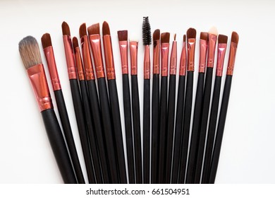 A makeup brush is a tool with bristles, used for the application of make up or face