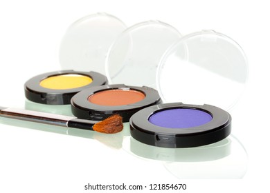 Makeup brushes with colorful eye shadows