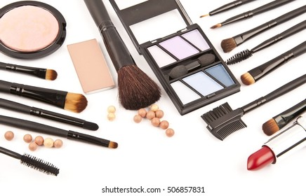 makeup brushes and cosmetics isolated on a white background