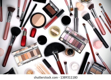 makeup brushes and cosmetics on a white background. professional set