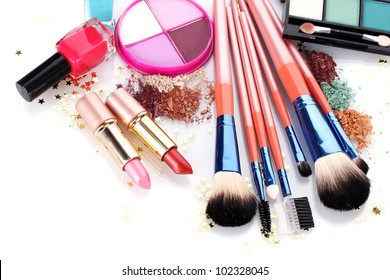 make-up brushes in holder and cosmetics isolated on white