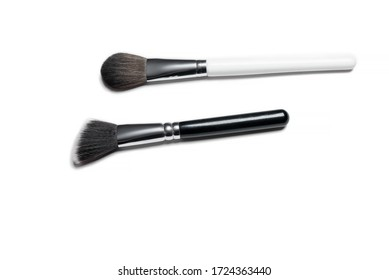Make-up brushes isolated over white background. Professional makeup brushes. Natural and synthetic bristles, black handles and elegant looking make up artist tools.