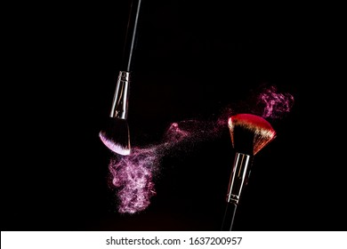 Makeup brushes on a black background