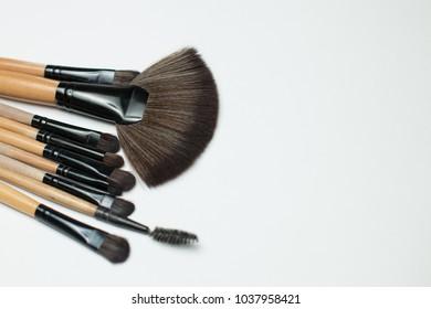 make-up brushes on white background