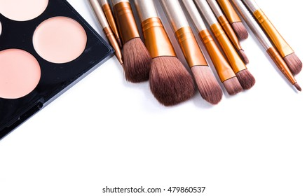 Makeup brushes set and foundation cream isolated