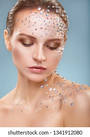 Makeup. Close-up of young woman with fashion makeup with rhinestone