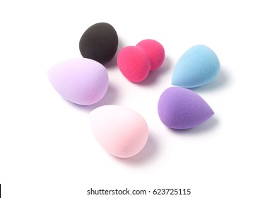 Make-up colored sponges on a white background