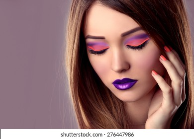 Makeup Concept. Beauty Fashion Model Girl with Bright Make up.