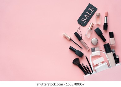 Makeup cosmetic perfume women products accessories pouring from shopping bag on pink flat lay background, beauty products cheap discount retail offer online purchase, top view above copy space