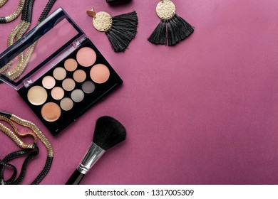 Makeup cosmetics with bijouterie on color background