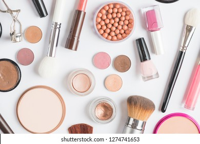 makeup cosmetics, brushes and other essentials on white background top view. beauty flat lay concept in red colors