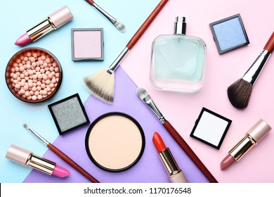 Makeup cosmetics with perfume bottle on colorful background