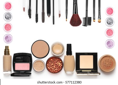 Make-up cosmetics set of liquid and cream foundations, compact and loose powder in various tones, bronzing pearls, blush, eye shadows, mascara and brushes isolated on white background. Top view point.