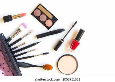 Makeup cosmetics tools background and beauty cosmetics, products and facial cosmetics package lipstick, eyeshadow on the white background.  Lifestyle Concept.