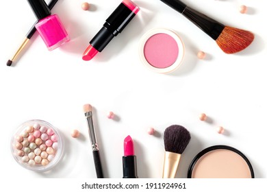 Make-up design template with brushes, pearls, lipstick and other products and tools. A flat lay on a white background with copy space